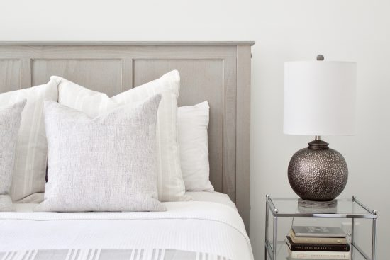A Nashville, Tennessee Interior Design New Condo Guest Room with Light Grey Headboard