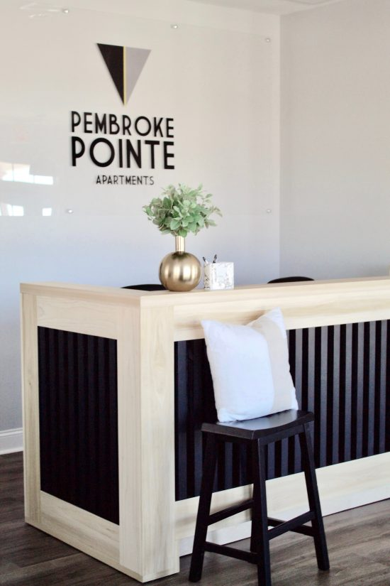 A Pembroke, North Carolina Interior Design Office & Community Center with Modern Reception Desk