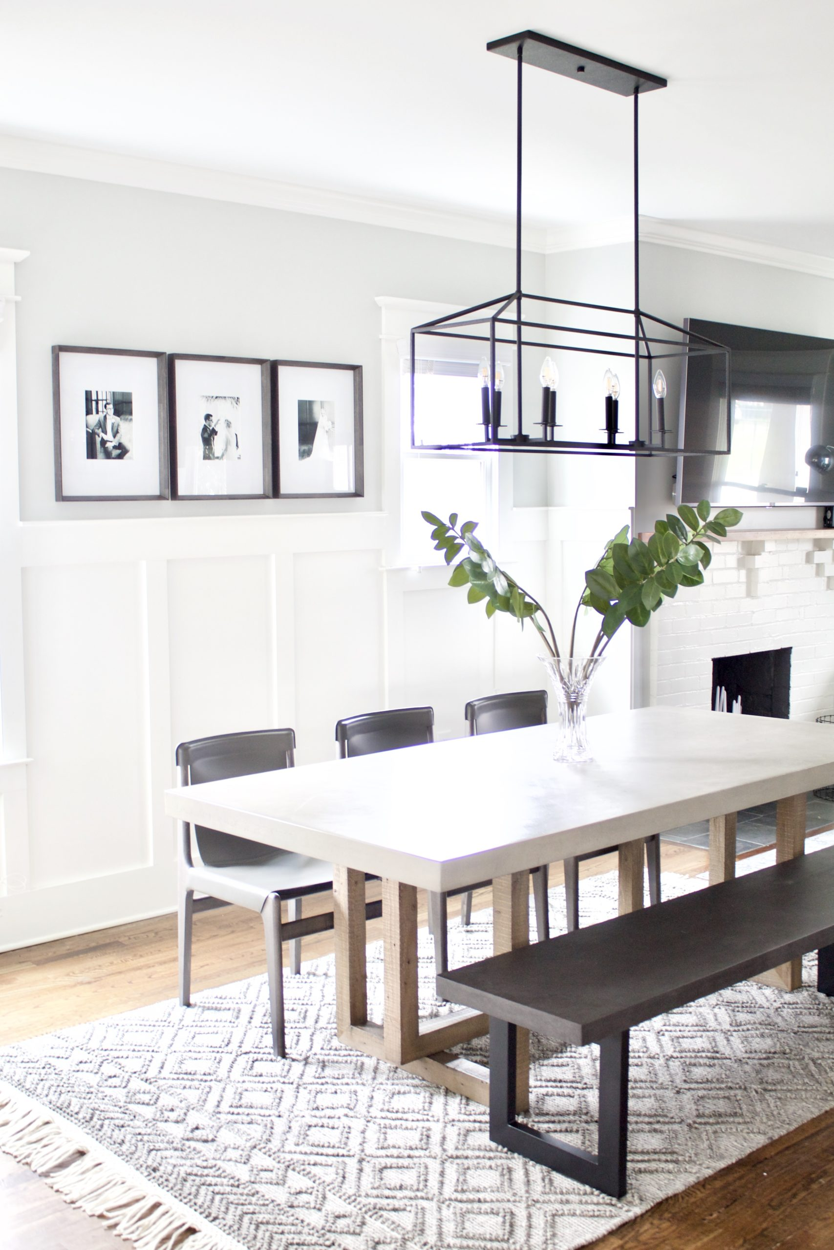 An 8-light black linear chandelier that is sure to grab your attention but not overwhelm your view. We used this light fixture for our contemporary craftsman eat-in kitchen dining space. It features an open rectangular frame that holds two sets of four candelabra bulbs.