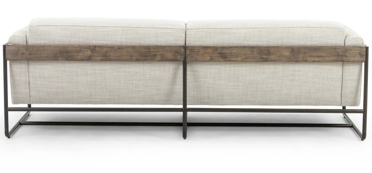 SHOP MY PICK: This leather strap suspended sofa is about as unique as they come. It features a black iron base, leather straps, rubberwood paneling, and beautiful taupe colored upholstered seating that appears to be floating.