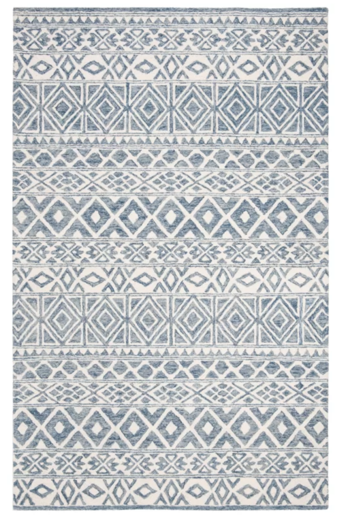 Visually alluring and expertly crafted, this Lauren by Ralph Lauren area rug brings decorative balance to any room of the home. A symmetrical composition of repeating shapes and motifs adorn rug to further display its stylish flair and charm.